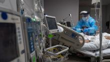 HOUSTON, TX - NOVEMBER 10: (EDITORIAL USE ONLY) A medical staff member treats a patient suffering from coronavirus in the COVID-19 intensive care unit (ICU) at the United Memorial Medical Center (UMMC) on November 10, 2020 in Houston, Texas. According to reports, COVID-19 infections are on the rise in Houston, as the state of Texas has reached over 1,030,000 cases, including over 19,000 deaths.  (Photo by Go Nakamura/Getty Images)