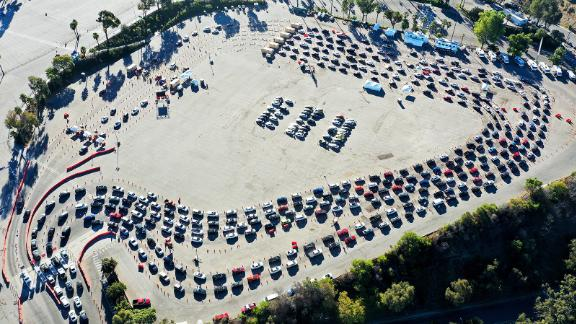 LOS ANGELES, CALIFORNIA - NOVEMBER 30: In an aerial view from a drone, cars are lined up at Dodger Stadium for COVID-19 testing on the Monday after Thanksgiving weekend on November 30, 2020 in Los Angeles, California. Health officials in Los Angeles County have issued a new limited stay-at-home order in effect for the next three weeks amid a surge in coronavirus cases. (Photo by Mario Tama/Getty Images)