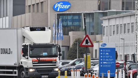 A temperature-controlled cold storage haulage truck leaves the Pfizer facility in Puurs, Belgium, on December 3, 2020.
