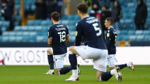 LONDON, ENGLAND - DECEMBER 05: Ryan Leonard of Millwall kneeling for black lives matter during the Sky Bet Championship match between Millwall and Derby County at The Den on December 05, 2020 in London, England. A limited number of fans are welcomed back to stadiums to watch elite football across England. This was following easing of restrictions on spectators in tiers one and two areas only. (Photo by Jacques Feeney/Getty Images)