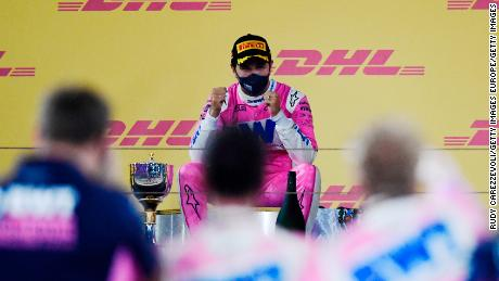 Perez sits atop the podium at the Sakhir Grand Prix in Bahrain on Sunday, December 6.