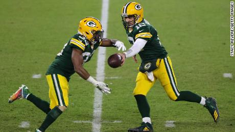 Aaron Rodgers, right, became the quickest quarterback to reach 400 career passing touchdowns on Sunday, doing so in just 193 games.
