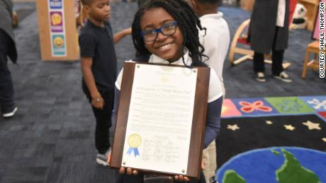 Selah Thompson with a proclamation given to her by the Atlanta City Council for her efforts to promote literacy.