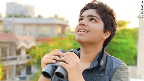 17-year-old Aman Sharma on the balcony of his New Delhi home, where he birdwatched during the lockdown.