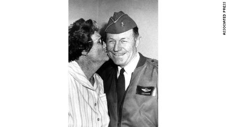 Susie Yeager implants a kiss on the cheek of her supersonic son, the Dean.  General Chuck Yeager in 1973.