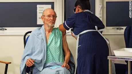 William Shakespeare, 81, receives the Pfizer-BioNTech Covid-19 vaccine, at University Hospital, Coventry, England on Tuesday.