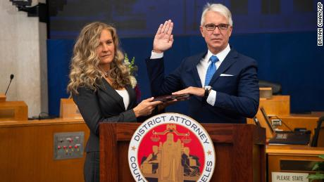 Incoming Los Angeles County District Attorney George Gascón is sworn in as his wife, Fabiola Kramsky, holds a copy of the Constitution.