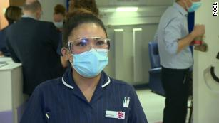 May Parsons, a nurse originally from the Philippines who has worked for the UK's National Health Service for 24 years, administered the first shot in Coventry.