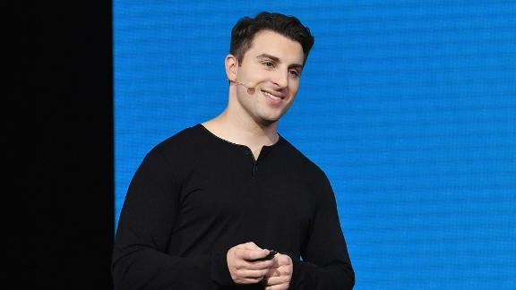 "Airbnb CEO Brian Chesky speaks onstage during ""Introducing Trips"" Reveal at Airbnb Open LA on November 17, 2016 in Los Angeles, California.  (Photo by Mike Windle/Getty Images for Airbnb)"