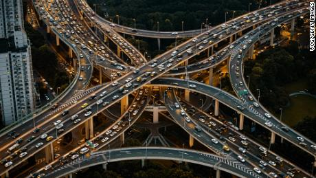 Vehicles are driven along the Yan'an Elevated Road in Shanghai, China. A new study finds that the mass of materials embedded in our roads, cars and much more may now exceed the overall weight of all biomass on Earth.