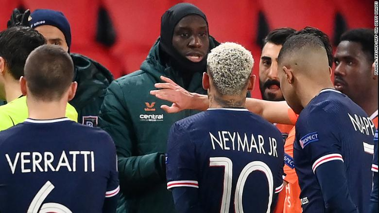 Istanbul Basaksehir's forward Demba Ba speaks to a number of PSG players.