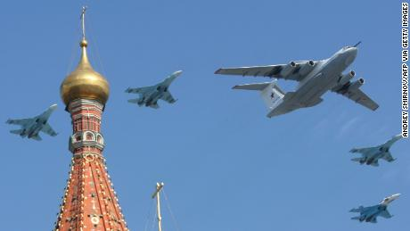 A Russian Il-80 plane and MiG-29 fighter jets fly over St. Basil's cathedral during the Victory Day parade in Moscow on May 9, 2010. t.    AFP PHOTO / ANDREY SMIRNOV (Photo credit should read ANDREY SMIRNOV/AFP via Getty Images)