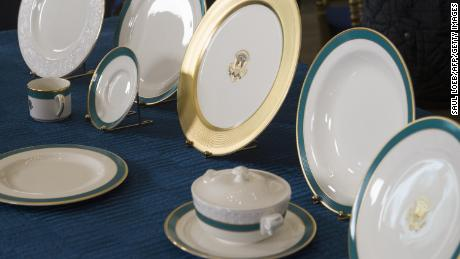 The Obama State China service, designed with the assistance of First Lady Michelle Obama, is seen in the State Dining Room of the White House in April 2015.