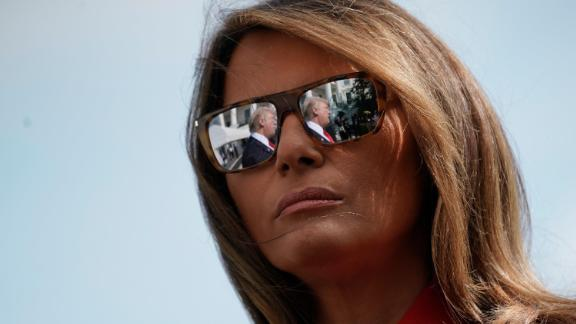 President Donald Trump's reflections are seen in the first lady Melania Trump's sunglasses as the President stops to answers questions at the White House in September 2017.