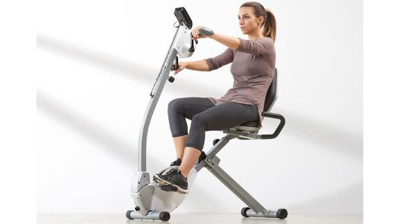 Vélo d'exercice couché peu encombrant avec mouvement du haut du corps