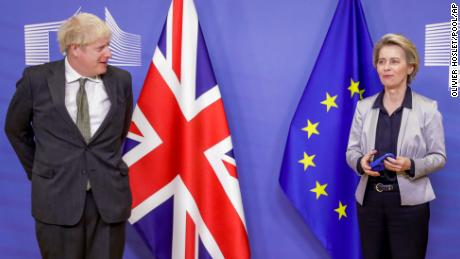 European Commission President Ursula von der Leyen, right, welcomes British Prime Minister Boris Johnson prior to a meeting at EU headquarters in Brussels, Wednesday, Dec. 9, 2020.