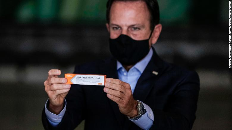Sao Paulo Gov. Joao Doria holds a box of Sinovac's Coronavac vaccine during a news conference on November 19, 2020 in Sao Paulo, Brazil.