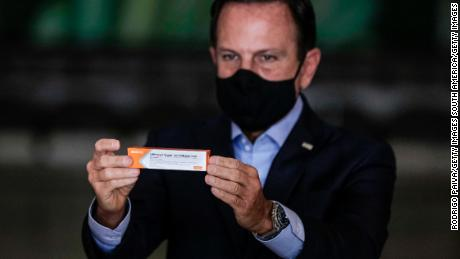 At a press conference in Sao Paulo, Brazil on November 19, 2020, Sao Paulo Governor Joao Doria holds a box of Sinovac's Coronavac vaccine.