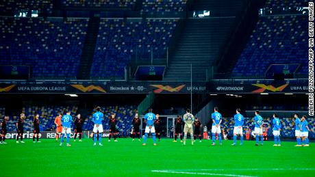 Players hold a minute's silence for late Italian football legend Paolo Rossi.