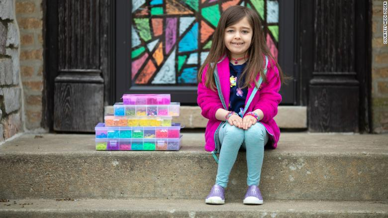 7-year-old's bracelet making raises $20,000 for hospital pandemic gear