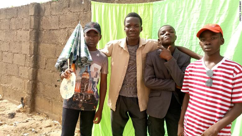 "Members of The Critics posing on the set of one of their short films, ""Chase,"" in Kaduna, Nigeria."