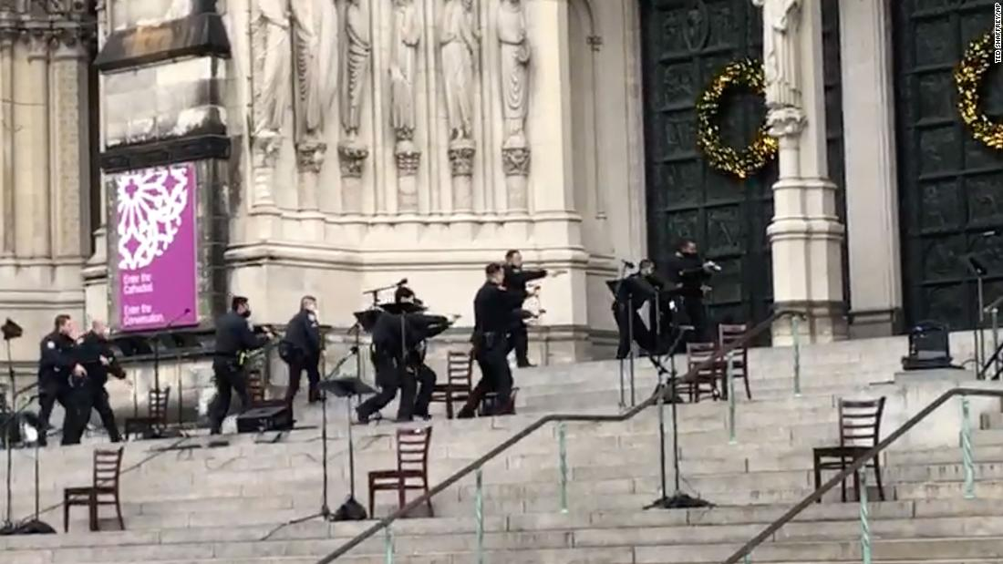 A gunman is dead after a shooting at a New York City cathedral Christmas concert