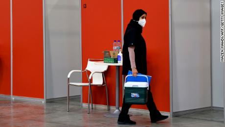 A worker in the Bahraini capital Manama's convention centre, which was repurposed  for Sinopharm vaccine trials, on August 27.