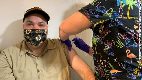 Andrew Miller, a housekeeper in the Environmental Management Service at the VA Bedford Healthcare System, was the first employee to receive the Covid-19 vaccine on Monday.