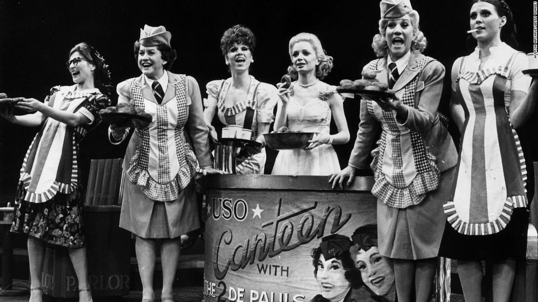 "Reinking, far right, sings during the Broadway musical ""Over Here!"""