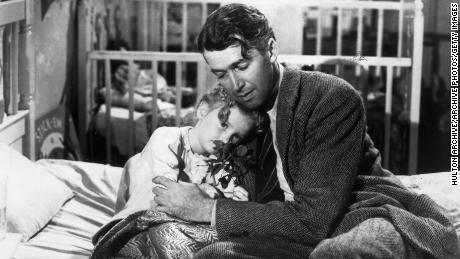 1946:  American actor James Stewart (1908 - 1997) as George Bailey, hugs actor Karolyn Grimes, who plays Zuzu his daughter, in a still from director Frank Capra's Christmas classic film, 'It's a Wonderful Life'.  (Photo by Hulton Archive/Getty Images)