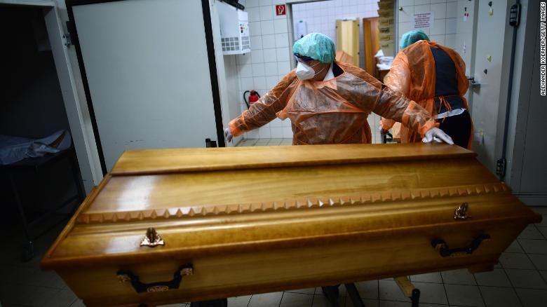 Funeral home workers move coffins of Covid-19 victims in Annaberg-Buchholz in the state of Saxony on December 7, as the country experiences a new surge in infections and deaths.