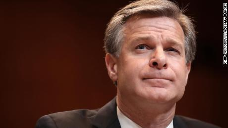 FBI Director Wray refutes the conspiracy theory that the January 6 rioters were `` bogus Trump protesters. ''