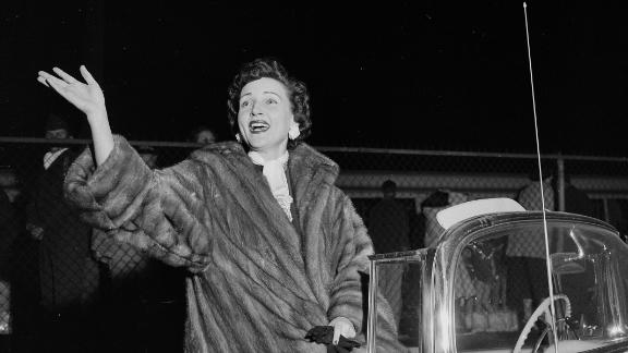 White rides in a Christmas parade in Los Angeles in 1955.