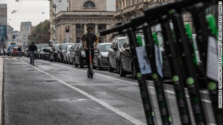 A man rides an electric scooter on a pop-up bike lane on Corso Buenos Aires, in Milan, on September 23, 2020.
