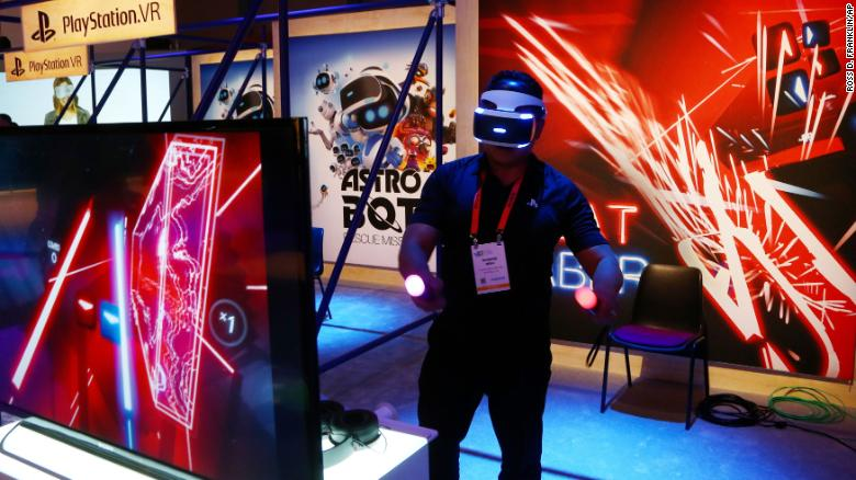 An  attendee plays the PlayStation virtual reality Beat Saber game at the Consumer Electronics Show International, January 7, 2019, in Las Vegas.