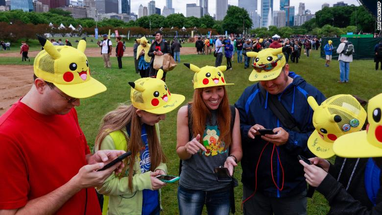 Tina Kellock (center) of Phoenix,  participates with family and friends at the Pokémon Go Fest 2019 in Chicago's Grant Park, June 13, 2019.