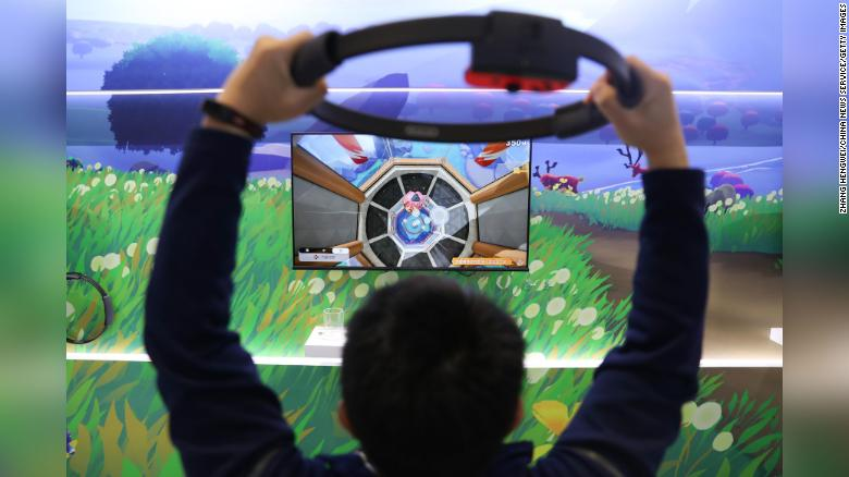 A visitor plays the Ring Fit Adventure game at the Nintendo booth during the Third China International Import Expo November 6 in Shanghai.