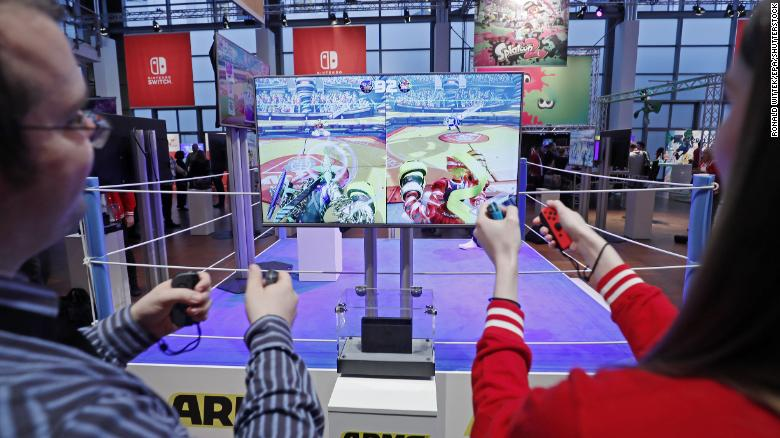 Visitors play Arms on the Nintendo Switch console during its German premiere in Offenbach, Germany, January 13, 2017.
