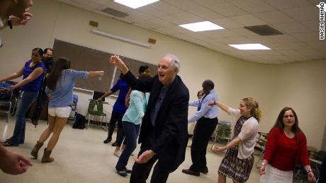 Alda works with students on an improv exercise.