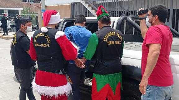 Peruvian police from an undercover unit known for the use of disguises adopted festive costumes for an anti-drug operation.