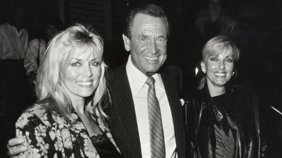 """Barker poses with two """"Price Is Right"""" models — Dian Parkinson, left, and Janice Pennington — in 1986. Parkinson sued Barker for sexual harassment in 1993, asking for $8 million. Barker denied the allegations and said they had a consensual relationship. The lawsuit was dropped in 1995."""