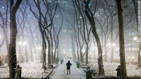 People walking in a snowstorm in New York City on Wednesday.