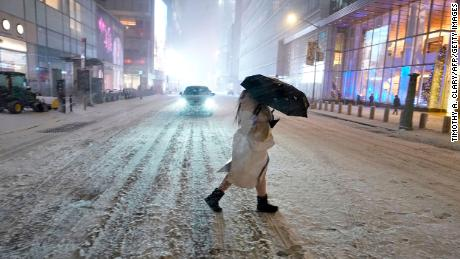 Snow blankets in New York City's Times Square on Wednesday.