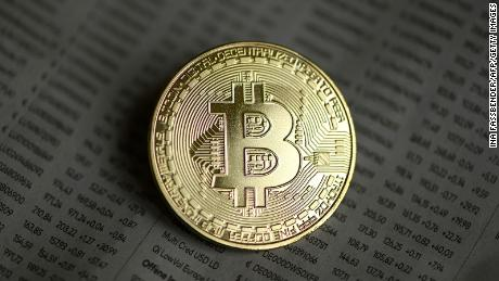 Bitcoin tops $20,000 milestone and continues to surge to record highs