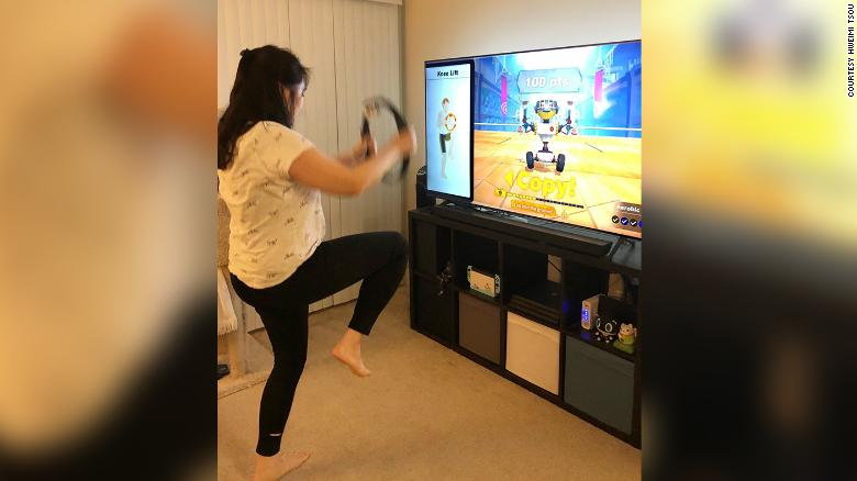 Bay Area resident Hweimi Tsou works out at home with Ring Fit Adventure on Nintendo Switch. Here she does knee lifts.