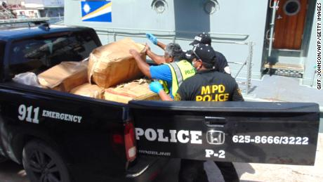 Marshall Islands police transport the confiscated packages of cocaine to an incinerator on December 15, 2020.