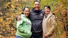 Philamena (left) smiles with her siblings, Phillip and Phillana Belone.