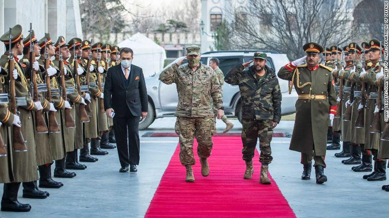 In this photo provided by the Pentagon, Gen. Mark A. Milley, chairman of the Joint Chiefs of Staff, walks through an honor cordon with Gen. Mohammad Yasin Zia, chief of general staff of the Afghan Armed Forces, at the presidential palace prior to a meeting with Ashraf Ghani, President of the Islamic Republic of Afghanistan in Kabul on December 17, 2020.