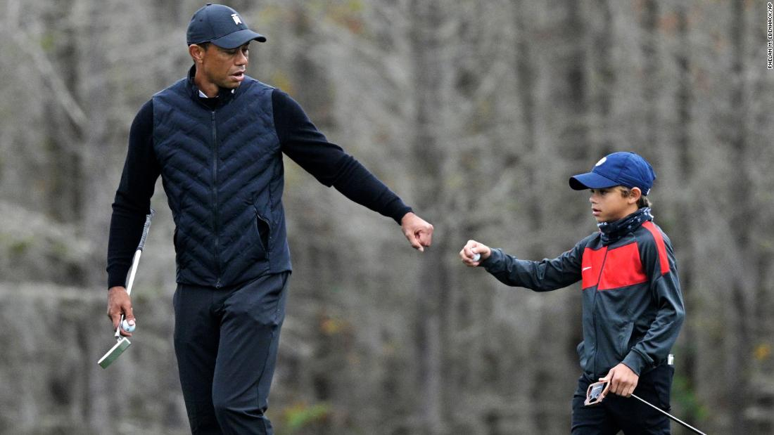 Tiger Woods warms up with son Charlie, 11, and the similarities are striking