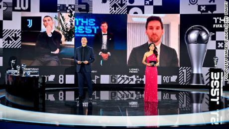 Lewandowski (C) beat Cristiano Ronaldo and Lionel Messi to the men's award.